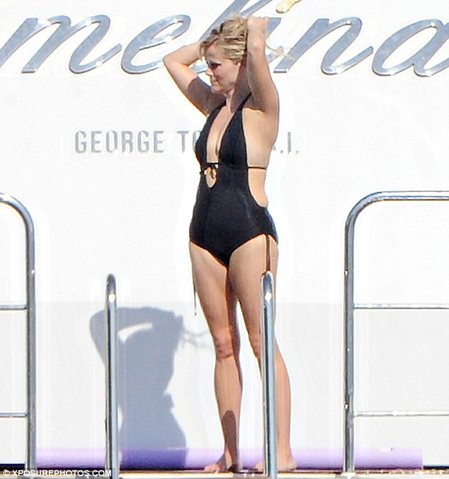 Taking the plunge! Reese Witherspoon shows off her sexy swimsuit body while on a girls holiday in Capri, Italy on Wednesday